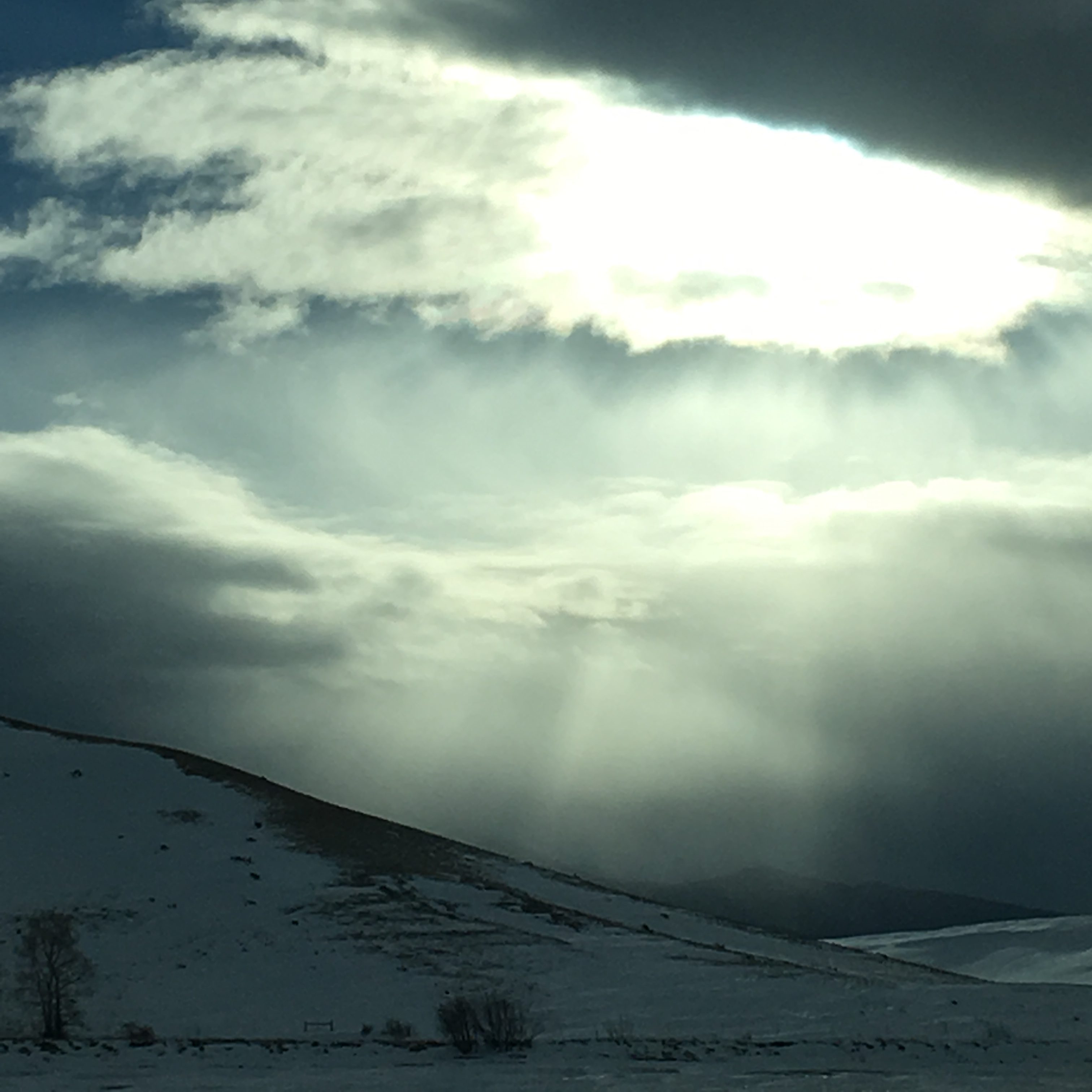 Rays of sun over snowscape